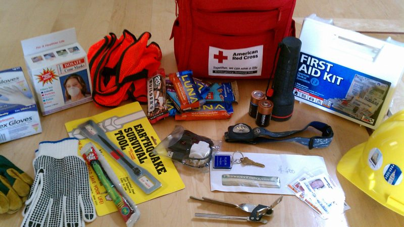 the contents of an emergency kit displayed on a table