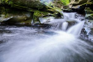 A water stream cascades down rocks.