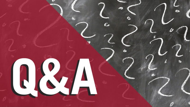 The letters Q&A over a chalkboard with question marks drawn in chalk