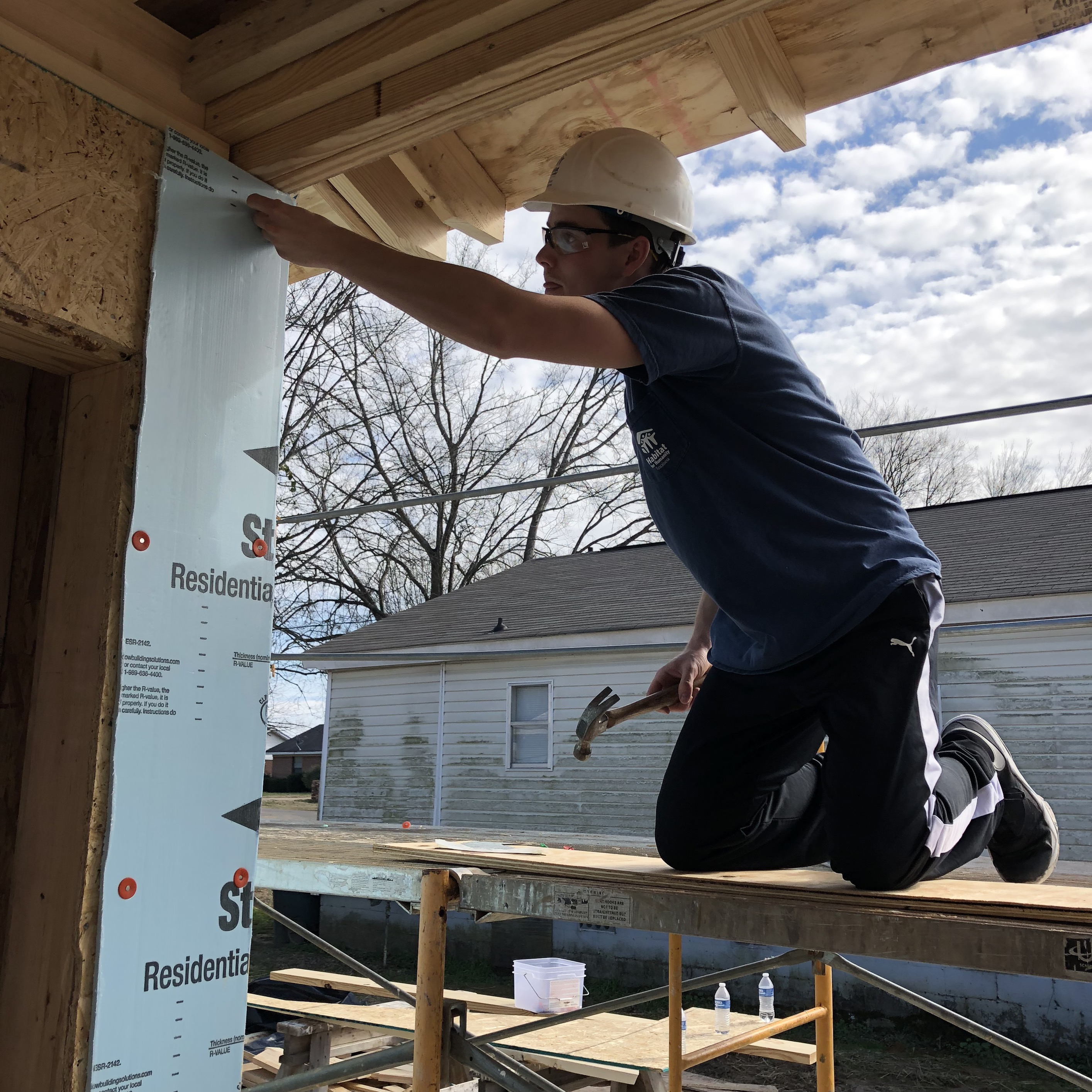 UA Habitat for Humanity student helping build a house.
