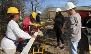 UA Habitat for Humanity students being supervised during a home build.