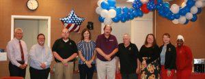 a group of nine UA SafeState staff members