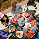 a view of six students eating on the terrace at Lakeside Dining Hall