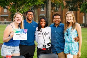 Five students posing for a photo during a past Weeks of Welcome event