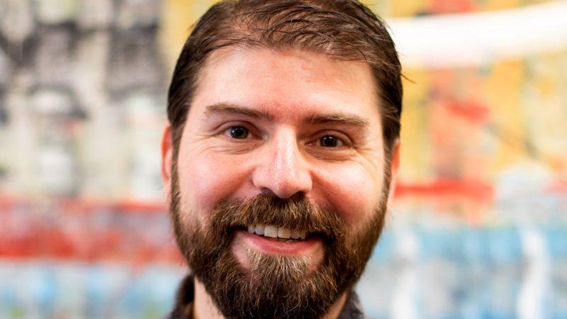A headshot of Andrew Raffo Dewar
