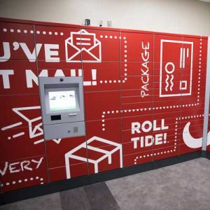 A bright red wall of lockers can be seen with a computer screen and several mail-related images.