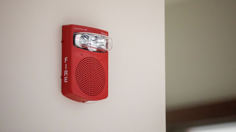 a red fire alarm on a wall