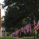 U.S. flags line the Quad with Denny Chimes in the background