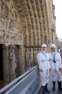 Jennifer Feltman and Iliana Kasarska on scaffolding in front of the cathedral's Last Judgment portal