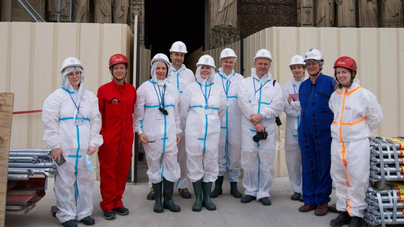 The group of researchers standing in front of the Cathedral of Notre Dame.