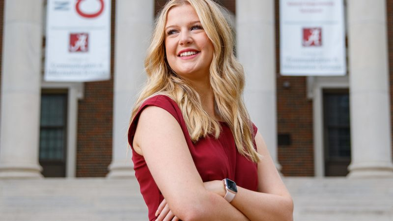 Ceara Burden posing in front of Reese Phifer Hall