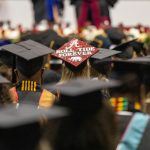 A decorated graduation cap that says Roll Tide Forever during spring 2021 commencement