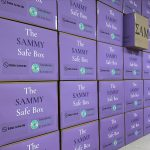 Numerous Sammy Safe Boxes stacked in a room