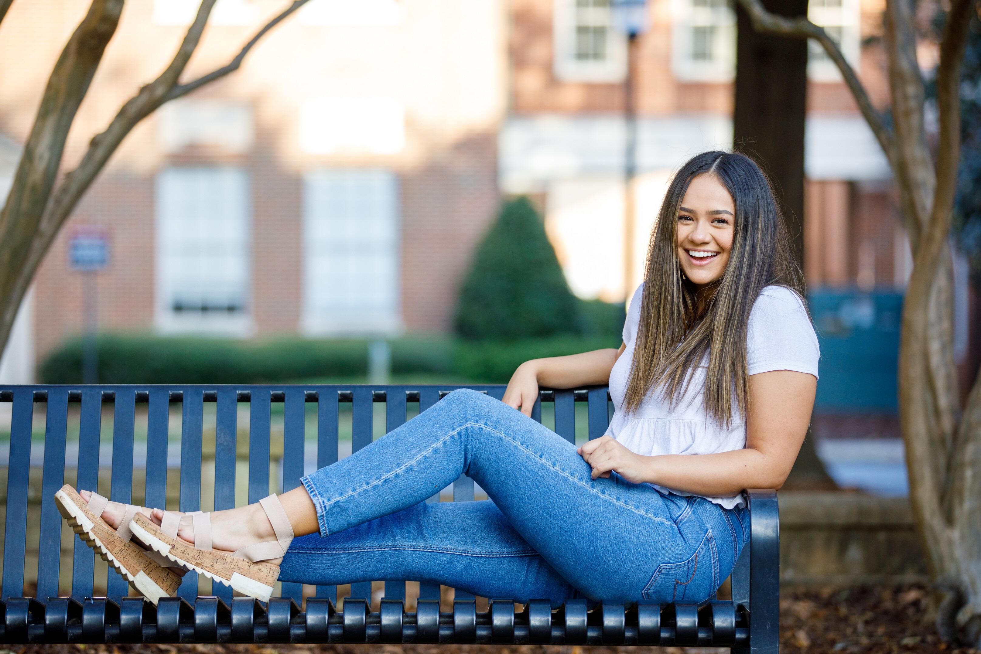 Jillian Keegan, National Hispanic Recognition Scholar, sitting on bench